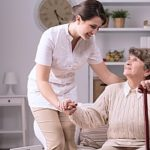 a hospice volunteer assisting an elderly patient in the comfort of her own home