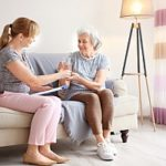 a senior receiving help from her daughter as she transitions into hospice respite care