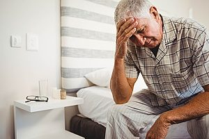 an upset senior with dementia experiencing mood swings