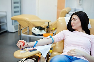 a woman who understands the benefits of donating blood and is participating in a blood drive