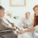Hospice nurse giving end of life care to older woman