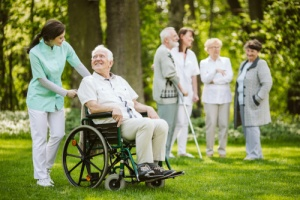 Older male experiencing end of life care from hospice chaplain