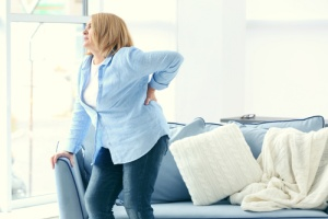 woman experiencing a symptom of chronic kidney disease (CKD)