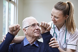 a hospice care specialist helping a patient with neurological problems