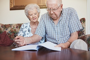 Elderly couple working on living will