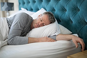 a man getting better sleep at night after working