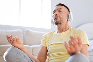 a man practicing guided meditation after learning about the importance of self-care