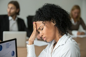 a woman who is learning how to avoid burnout to deal with her workplace stress