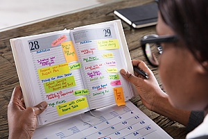 woman looking at her schedule to ensure a healthy work-life balance