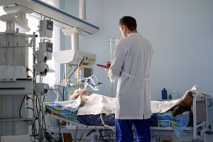 a doctor attending to a patient who is in a coma