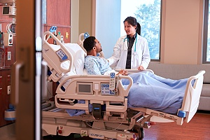 a patient recovering from a coma talking to a nurse