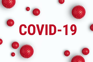 the words COVID 19 spelled out in red on a white background