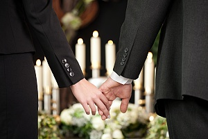 people holding hands after a death in the family