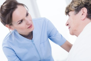 caregiver talking to patient in stages of dying