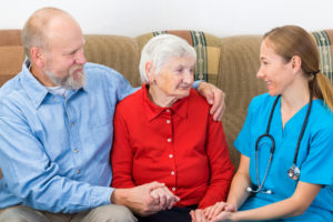 hospice volunteer speaks to a patient and her family member