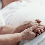 older couple learning how pain management in hospice is done