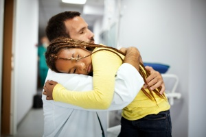 doctor comforting a kid after knowing talking to children about death