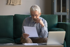 older man looking at a do not resuscitate order