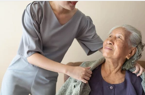 Careperson Giving Jacket to the Elder Lady knowing difference in hospice care vs palliative care