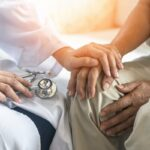 Pain Management During Hospice Care- Doctor Holding Patient Hands